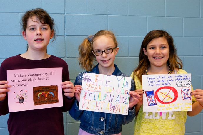Students design posters to encourage classmates to stop bullying